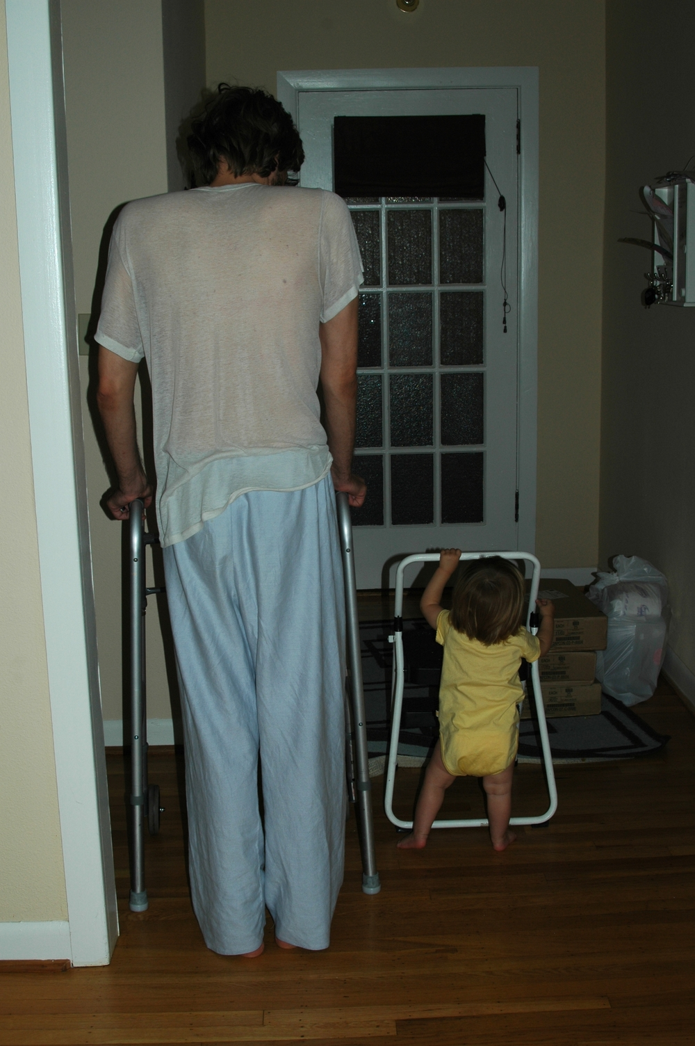 Matt and his daughter, nearly nine years ago, learning to walk together.