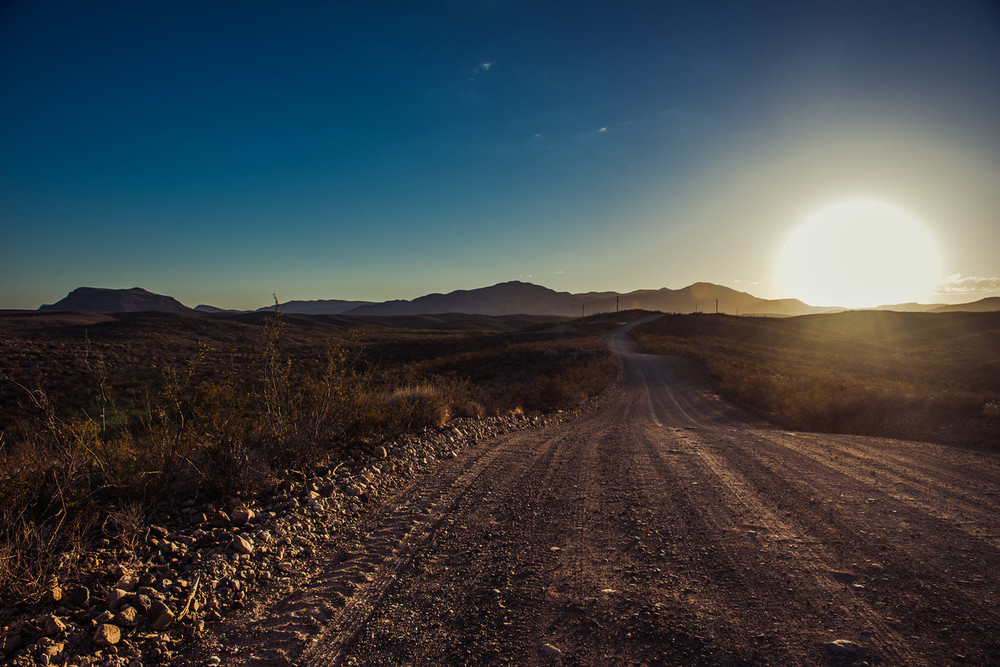 The gravel road from the Hot springs at sunrise.Chinati Hot Springs, Ruidosa, Texas.