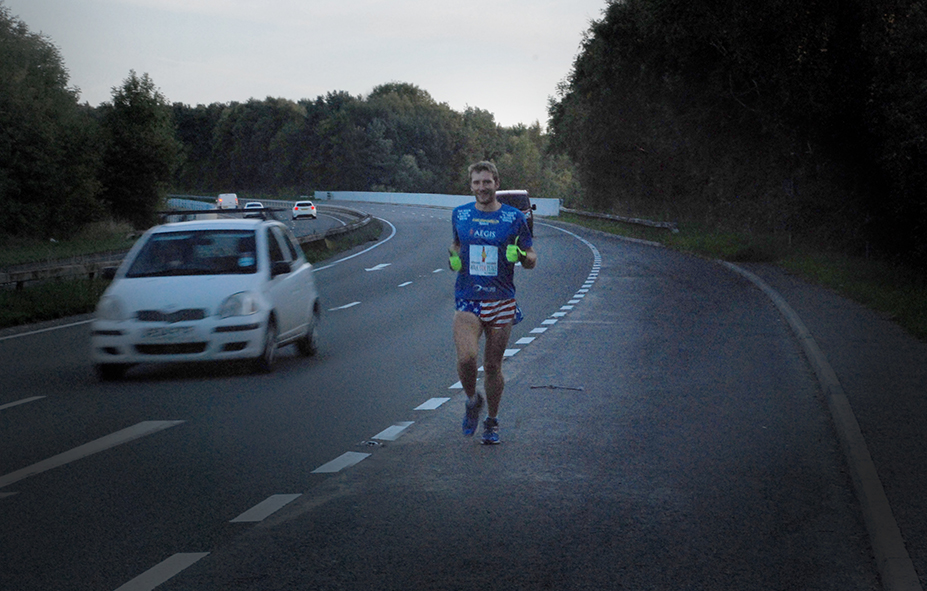 Marathon Man Rob Young running down road into Sheffield. After world record marathons in a year.