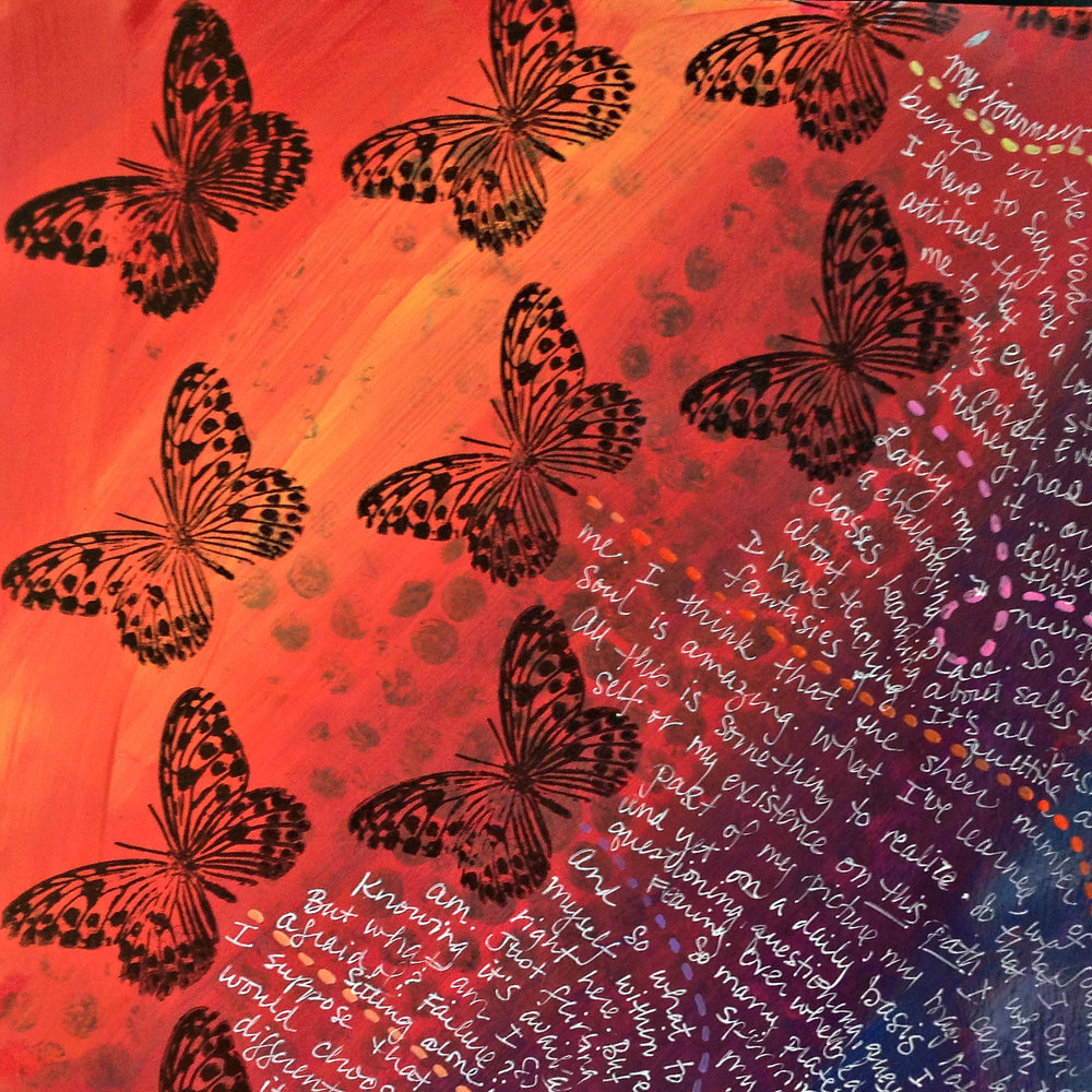 Repeated butterfly stamps create a background pattern that led to journaling.