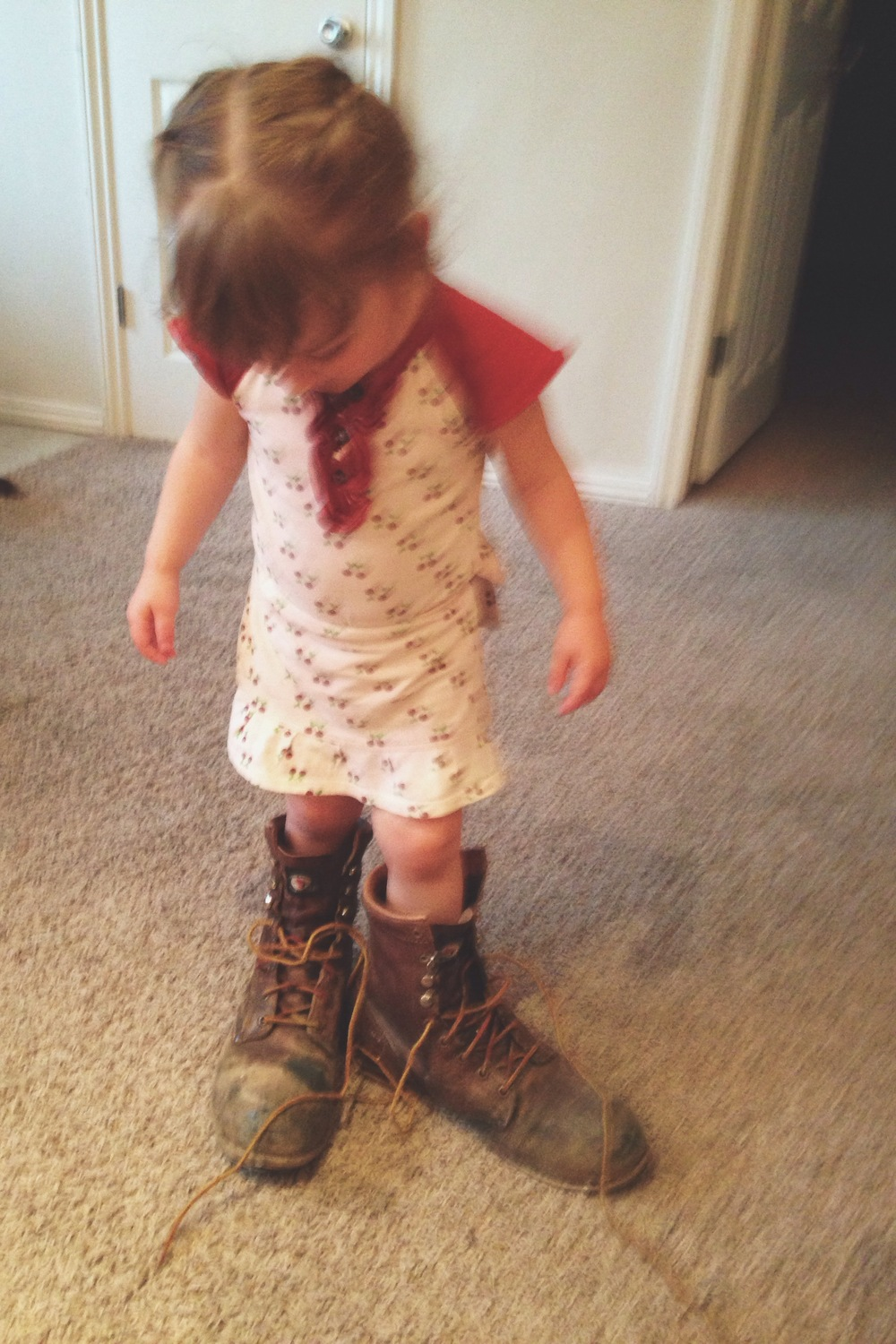 I have to end with this one. Alice wearing her Daddy's work boots. Kills me.    Happy Spring!