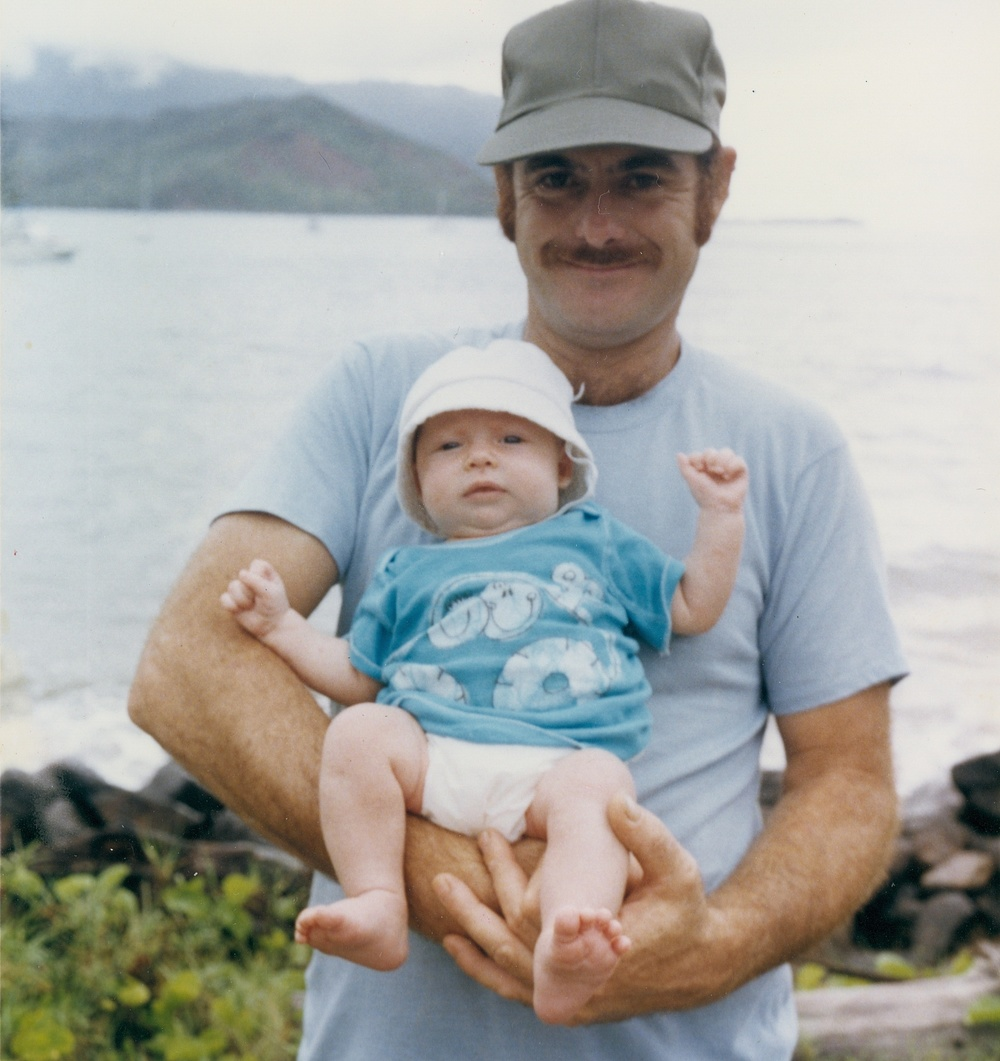 Gary holding Fern in Hanalei Bay, 1985.