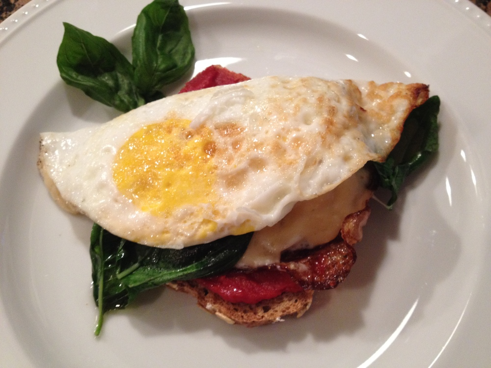 Egg on Toast with Sun dried Tomatoes & Basil