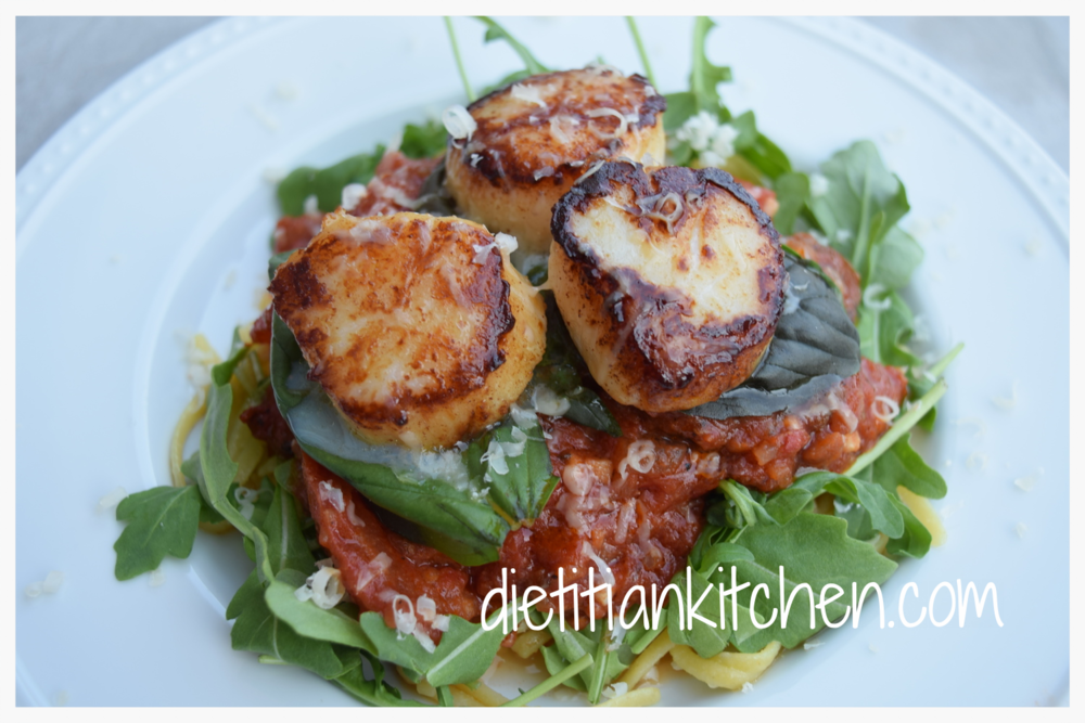 Seared Scallops over Basil Arugula Salad
