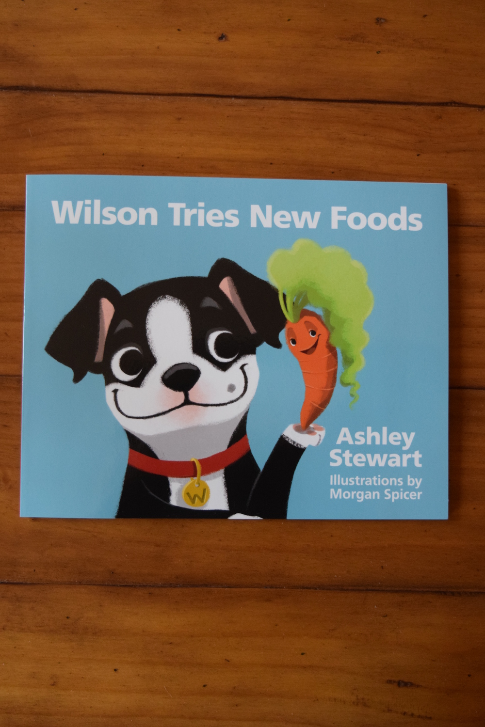 Join Wilson, the Boston terrier, on a path to healthier eating with your kids! visit  eatwellwithwilson.com  to purchase!