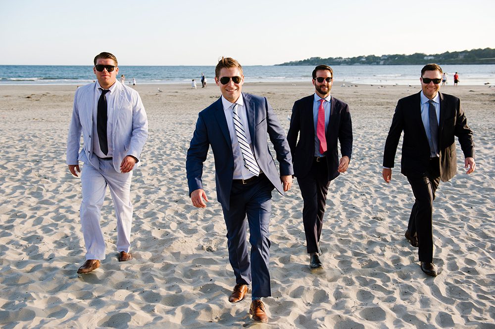 Groomsmen walking on the beach at the Newport Beach house