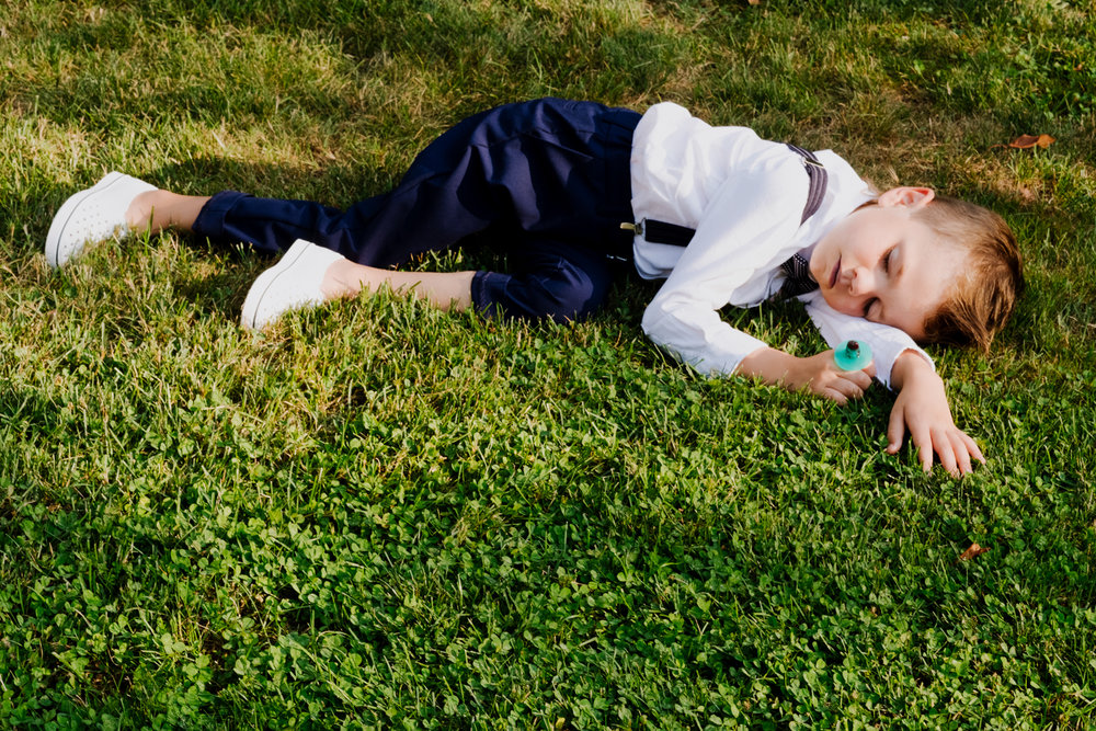 Ring bearer sleeps during ceremony