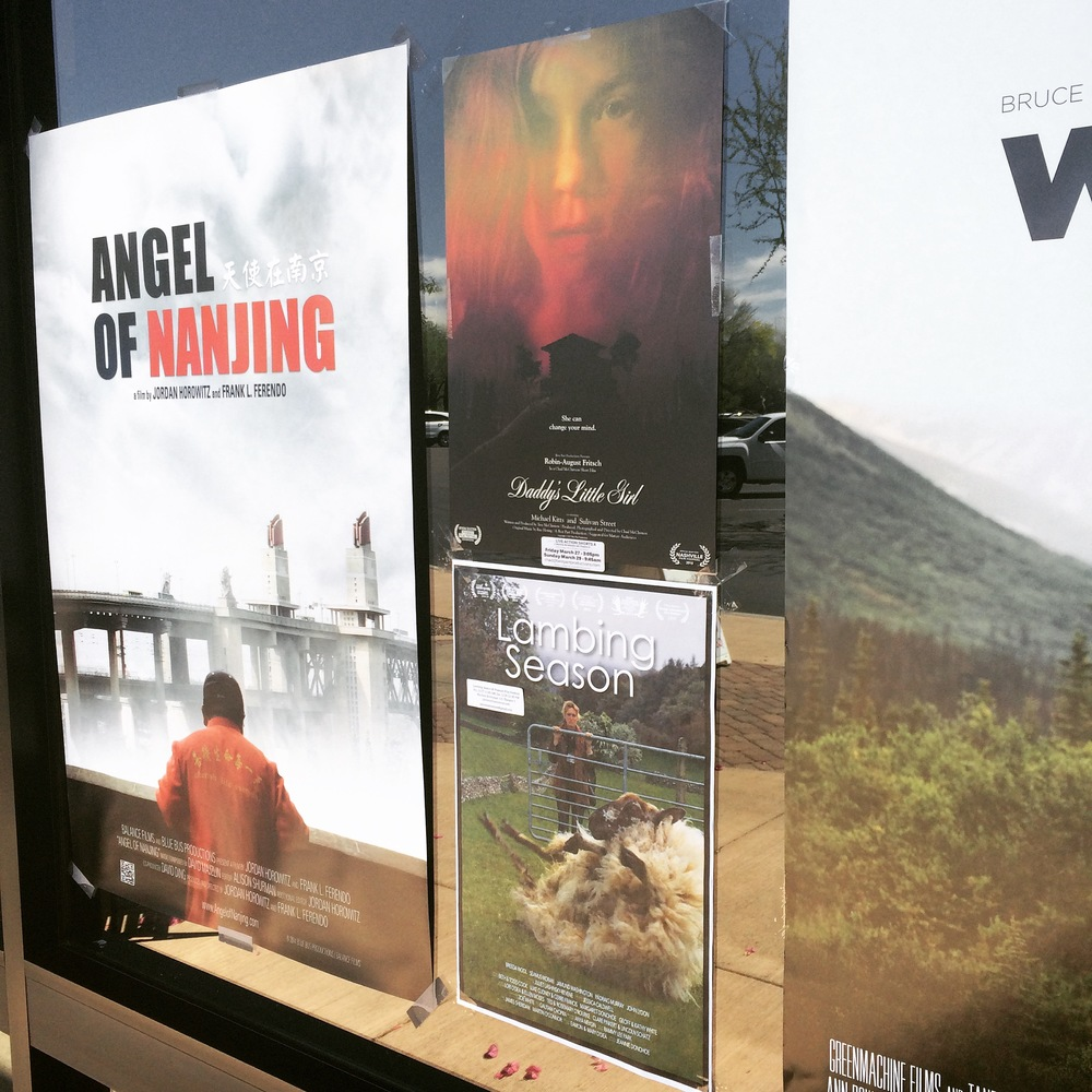 Poster hanging next to some other REALLY incredible films. Lambing Season was a favorite of ours from  deadCenter Film Festival  last year, and  Angel of Nanjing  &  Wildlike  were our two favorite features at the PFF this year. (Also, unsurprisingly, the winners of best doc and best feature).
