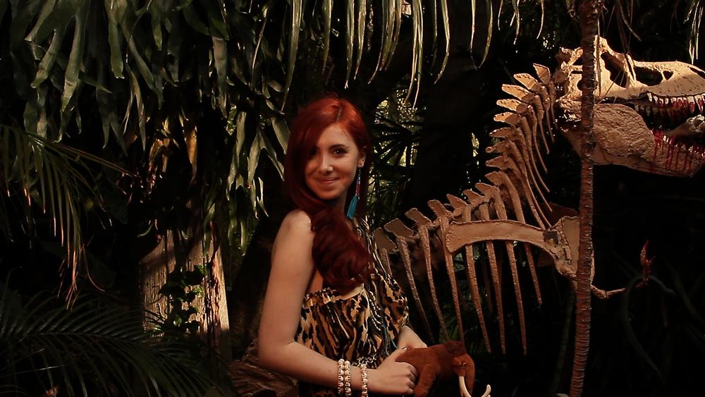 Cavegirl next to T Rex.jpg