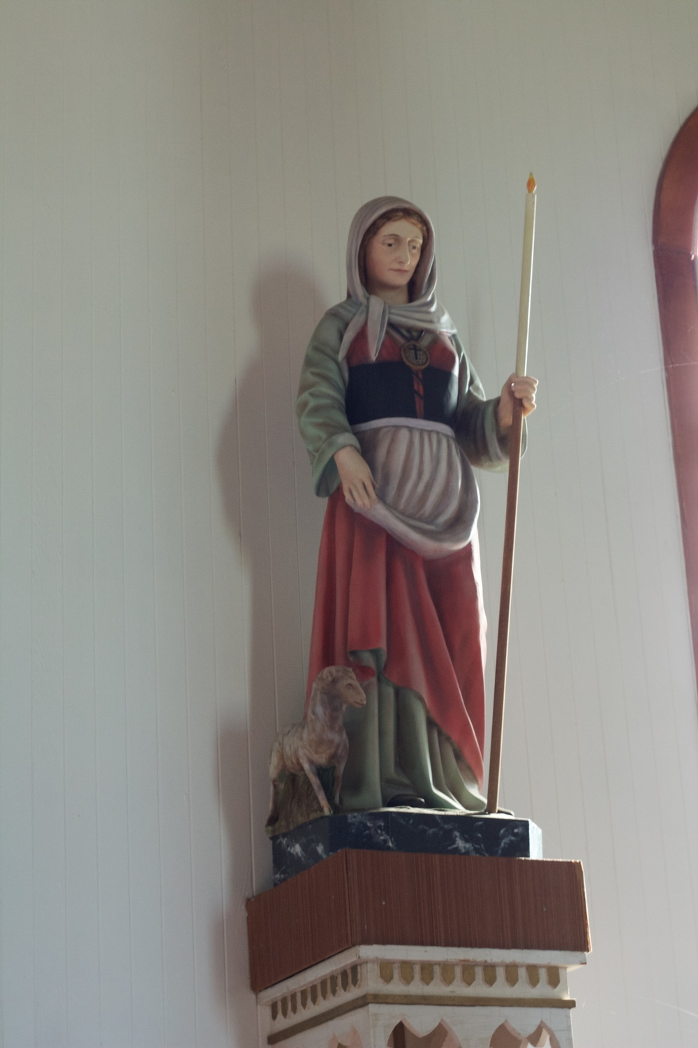 A statue of Ste Geneviève inside the church.