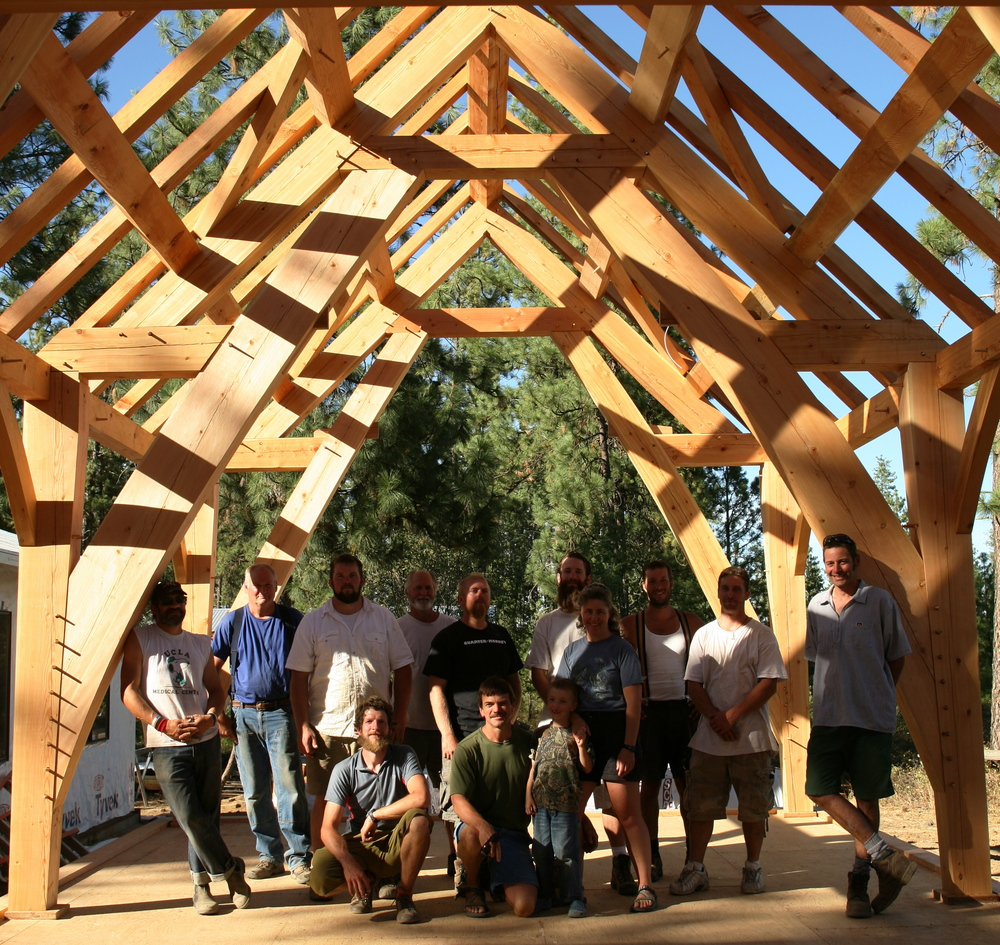 The crew under a Timber Frame sling brace truss in Spokane, Washington.
