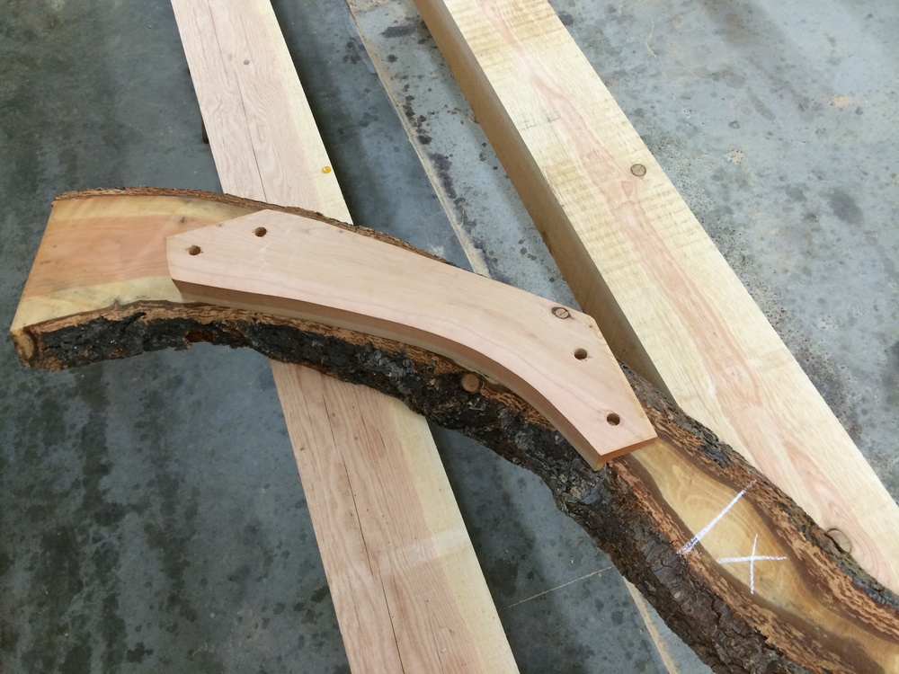 A finished brace on top of an unfinished brace.