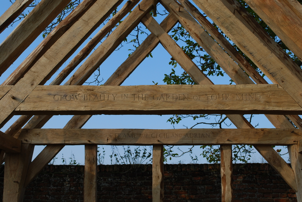 "The inscription on the outer tie beam carved by Rupert Newman says ""Grow Beauty in The Garden of Your Mind."" This faces out into the walled Elizabethan garden. The phrase was written by Laurie Smith."