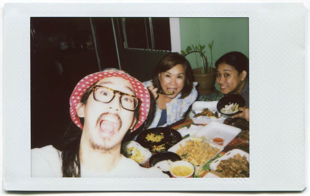 Me, Mama, and Big Sis chowing to on some Pad See Ew. Not ew at all...
