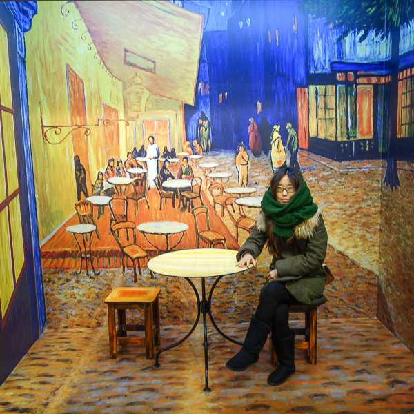 "You stroll through the museum and take photos in front of three-dimensionalized paintings, including Van Gogh's ""Cafe Terrace at Night."""