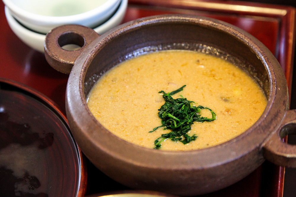 Perilla Seeds Soup with tofu and wild greens topping (들깨탕 = Deul Kkae Tang).