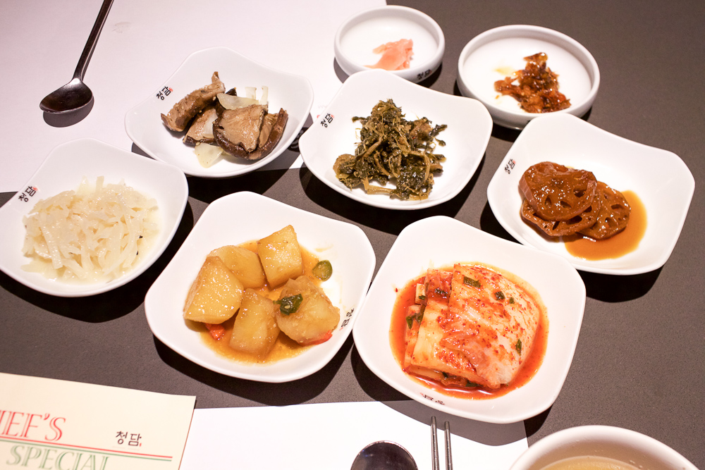 Parade of banchan (side dishes) at Chungdam.