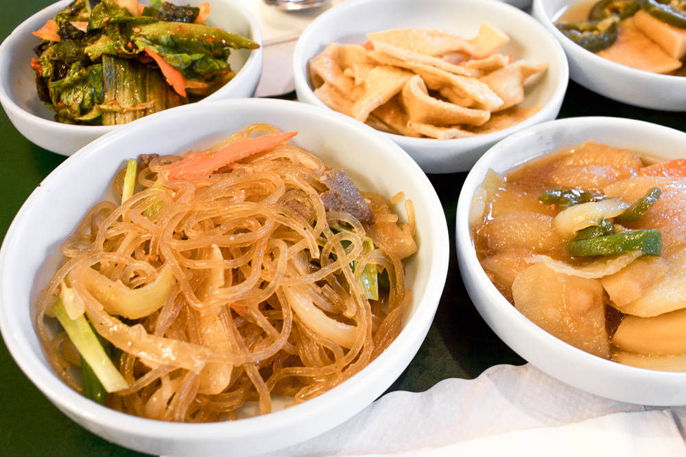 Japchae (Korean glass noodles) on the left. My preferred side dish at Choi's Korean Restaurant.