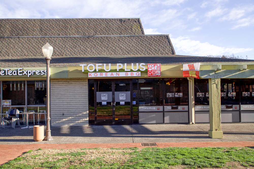 Storefront. Tofu Plus is next to tea and jerky shops.