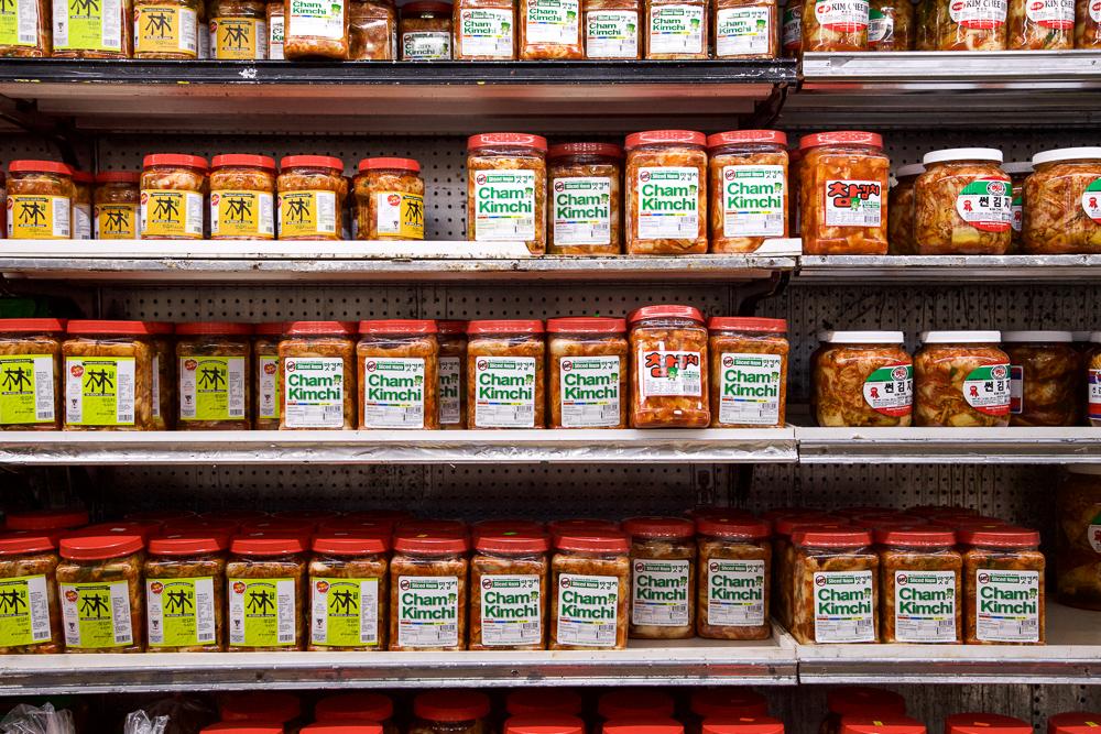 Rows of various kimchi at Kyopo Market.