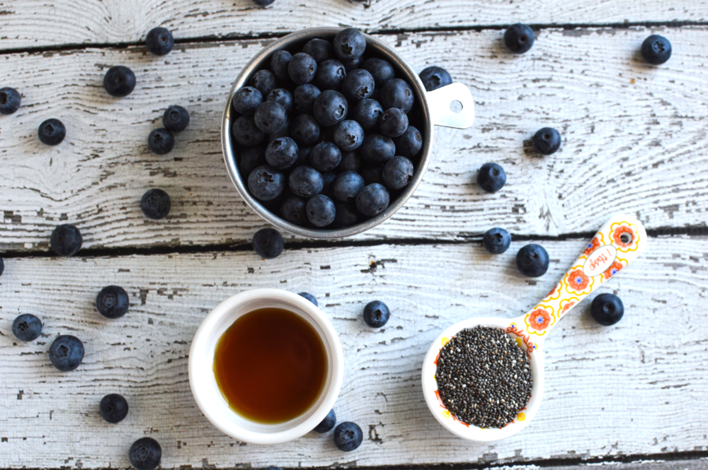 3 Ingredient Blueberry Chia Jam is easy to make, tastes delicious and much lower in sugar than most store bought jams and jellies! #easychiajam #homemadejam #healthyjam #veganjam #paleojam