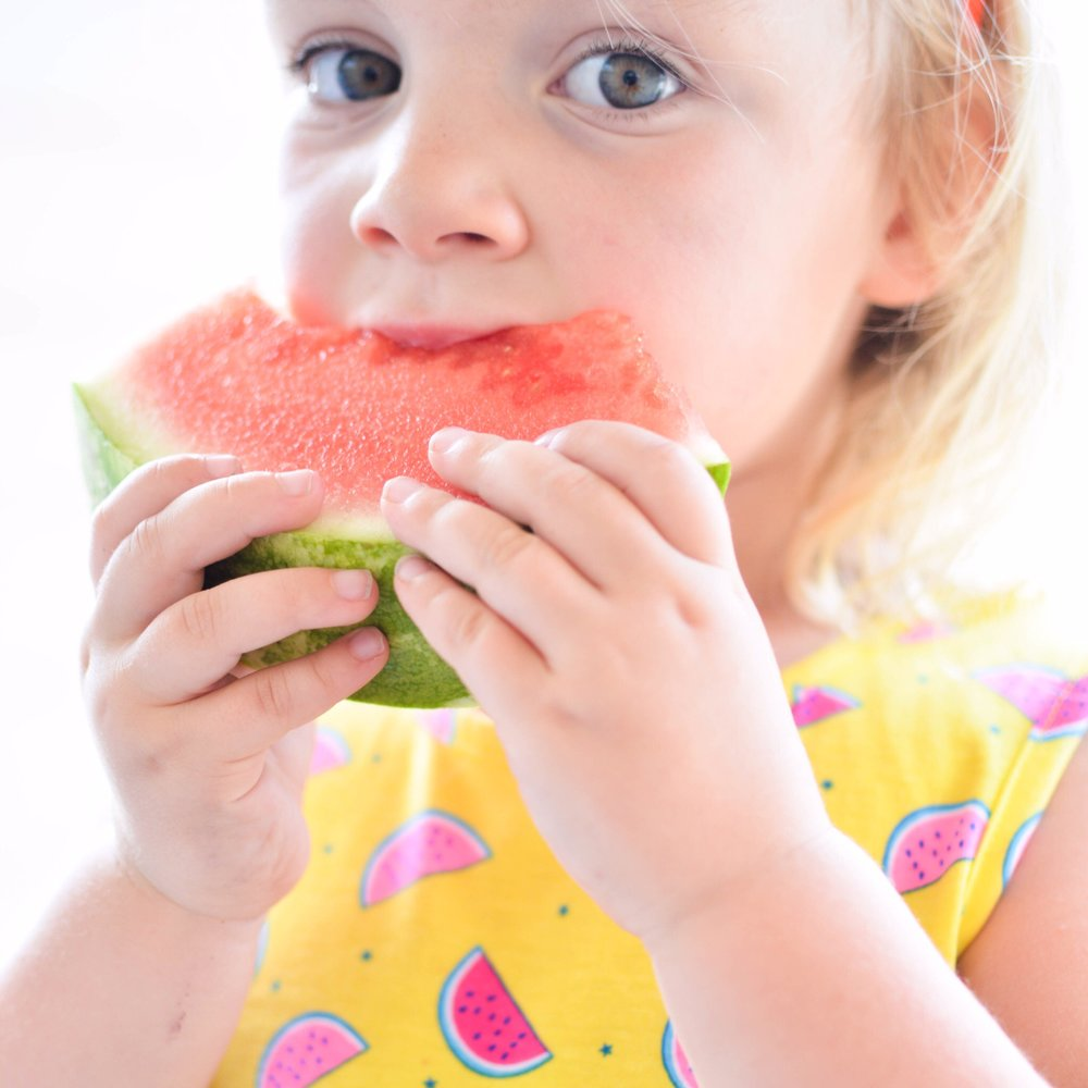 girl-eating-watermelon-thenaturalnurturer