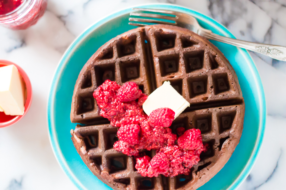 Fluffy, perfectly chocolaty, protein-rich, and mixed entirely in your blender,these Flourless Chocolate Waffles (with greens!) is made with oodles of good for you ingredients and are the perfect way to start any day! Naturally Paleo, gluten free, dairy-free and deliciously veggie-loaded! #hiddenveggies #veggierecipesforkids #paleowaffles #glutenfreewaffles #healthywaffles