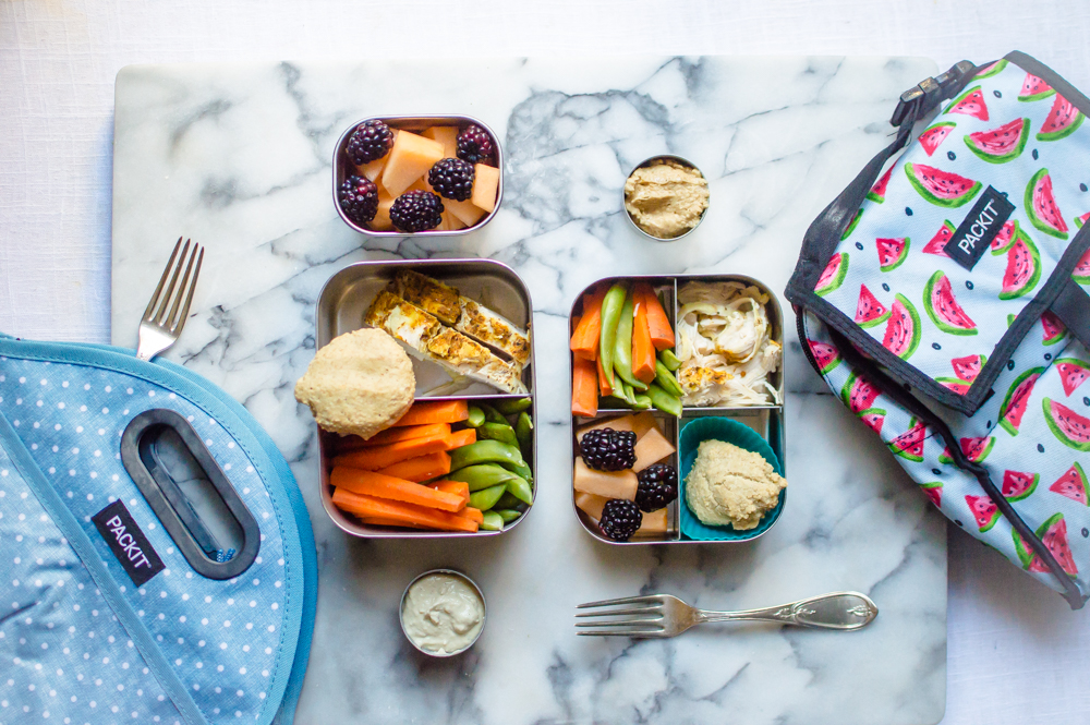 For me: Seasoned chicken breast, grain-free biscuit, carrot sticks & sugar snap peas with hummus for dipping, and cantaloupe with blackberries.  For little one: Same as mama, only with natural peanut butter for dipping veggies in. Hummus isn't my daughter's favorite thing, so I am happy to give her another protein-packed dip