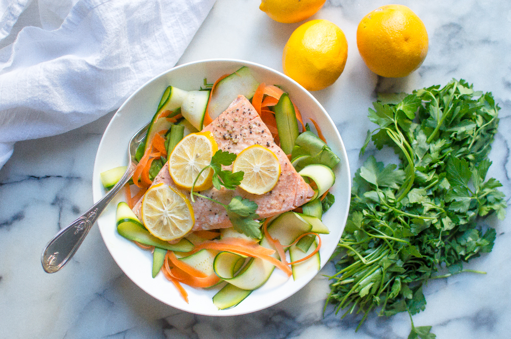 Instant Pot Lemon Garlic Salmon is going to rock your socks then! Wildly easy to throw together, super flavorful and cooked to perfections FROM FROZEN in your handy dandy IP....this going to be your new fast food! #whole30instantpot #paleoinstantpot  #whole30recipes #realfoodinstantpot #healthyinstantpotrecipes