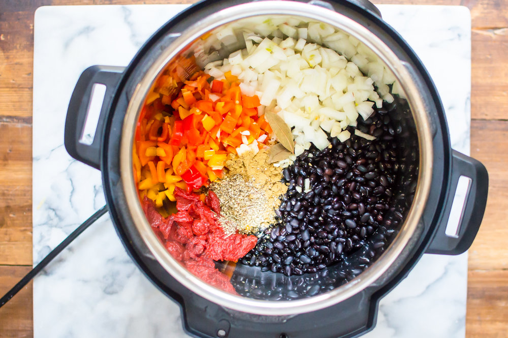 Easy on the budget and cooked from dry in a relatively short amount of time with the help of a handy dandy pressure cooker, this recipe for Instant Pot Cuban Black Beans is full of flavor and real food goodness that will make real food realistic on so many levels. #healthyinstantpot #beansfromdry #instantpotbeans