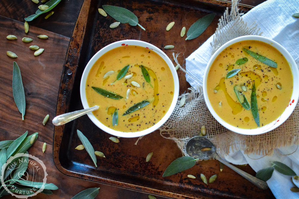 Savory Pumpkin Soup celebrates the lovely, seasonal flavor of pumpkin without chaining you to the stove when you'd much rather be jumping in leaf piles. Completely dairy-free, Whole30 compliant, Paleo , and vegan! #whole30soup #whole30pumpkin #vegansoup #veganpumpkinrecipe #paleosoup #paleopumpkinrecipe #dairyfreesoup #thenaturalnurturer #thenaturalnurturerrecipes