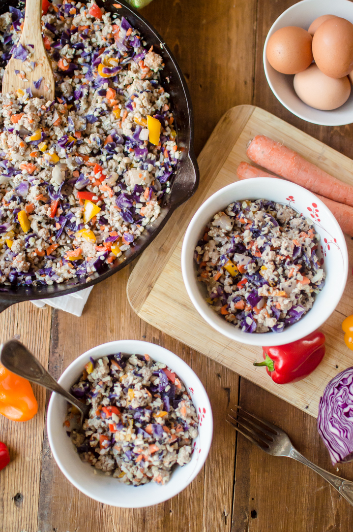 20-Minute Pork Fried Cauliflower Rice is easy, seriously delicious dinner that serves up oodles of flavor and a boatload of veggies! A healthy twist on a classic comfort food so many of us love, this easy peasy recipe is Paleo, Whole30 compliant, veggie-loaded and will completely dazzle your eyes and your tastebuds. #whole30dinner #paleodinner #whole #paleo #veggieloaded #veggieloadeddinner #glutenfreedinner #healthycomfortfood #thenaturalnurturer #thenaturalnurturerrecipes