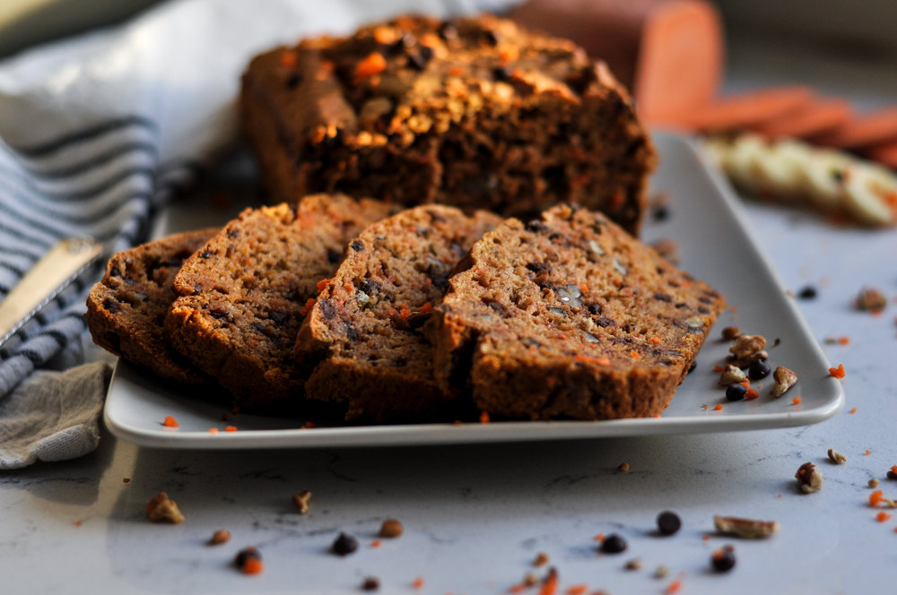 Looking for a veggie-packed bread that's gluten-free & dairy-free?  Carrot Chocolate Chip Bread is packed with sweet potatoes, carrots and bananas and a handful of chocolate chips for a little chocolatey goodness. #glutenfreebaking #veggieloaded #veggieloadedbaking #dairyfreebaking #hiddenveggies