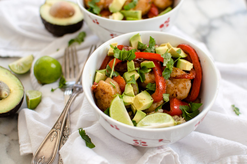 The perfect veggie-loaded dinner for Taco Tuesday or any other night of the week, Veggie-Loaded Shrimp Taco Bowls are going to become a go-to meal in your house.  Easy enough to make for a busy weeknight dinner and full of veggies, protein, and healthy fat, this dish is Paleo, Whole30, gluten free and dairy-free #whole30recipes #veggieloadedinners #paleodinner #paleorecipes #whole30 #glutenfree #tacotuesday