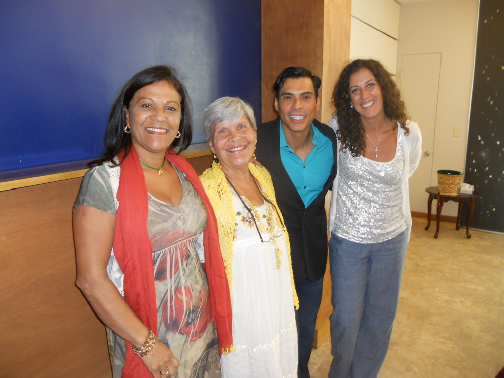 "Presentation of ""La filosofía de mi gata andariega"" at Unity on the Bay Spanish Service (6/22/14): Rosa Zerpa, Elena, Rafael Toruño and a congregant."