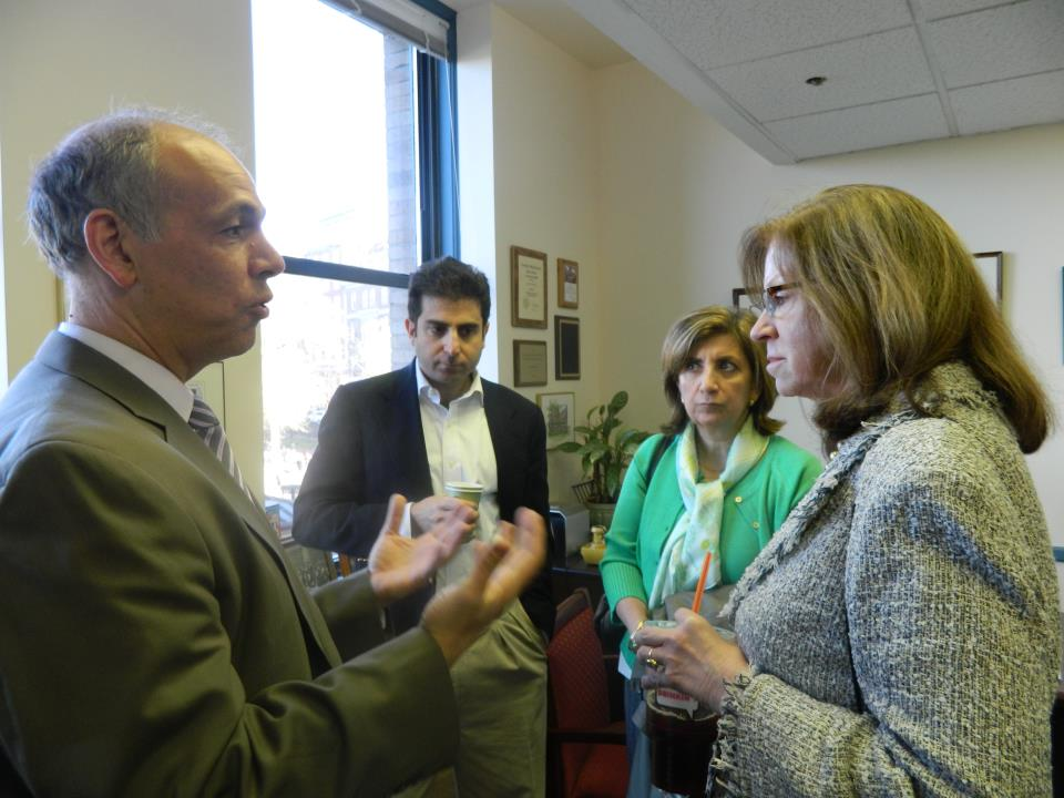 Charles and clients discuss legislation with former Senate President Therese Murray