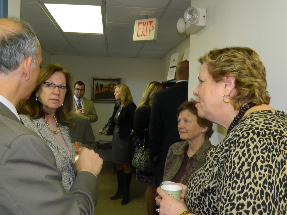 Joan Cirillo of Operation ABLE speaks with former Senate President Therese Murray