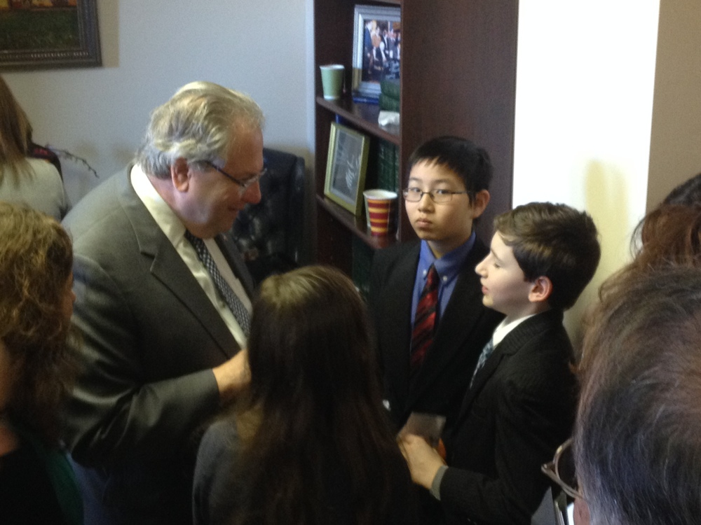 Students speak to Speaker Robert DeLeo about the issue of youth homelessness
