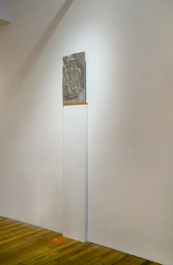 Interpreter II   2013 Magnesium embossing plates, wood and glass 33  ½  x 26 x 1  ½  in/ 85.1 x 66.1 x 3.8 cm