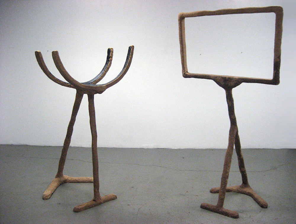 The Framer  and  The Holder     2010 Sawdust, gel-medium, wood and tar 86 x 40 x 30 in/ 218.4 x 101.6 x 76.2 cm // 60 x 30 x 30 in/ 152.4 x 76.2 x 76.2 cm