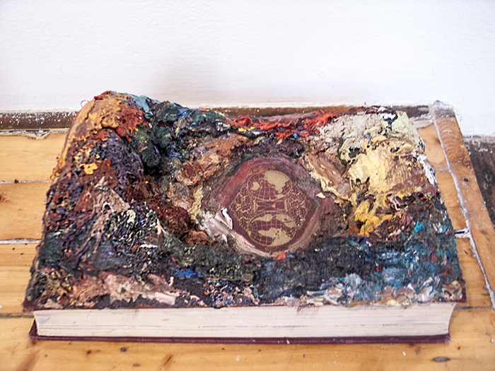 Island   2012  Book and oil paint  9 ½ x 6 ½ x 4 in/ 24.1 x 16.5 x 10.2 cm