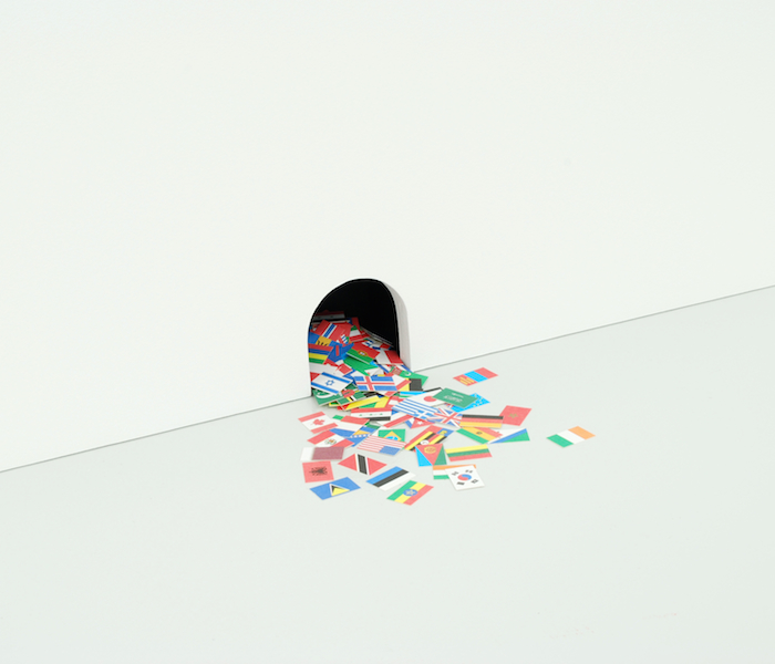 An Astonishing New Collection of Oddities from Every Corner of the Globe   2010 Paper and cut hole in wall 2 ¾ x 2 ½ in/ 7 x 6.4 cm