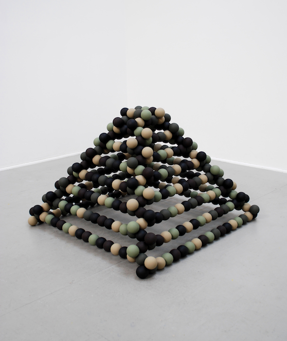 A Pyramid Unfinished   2008 Wood, steel rods and camouflage paint 36 x 36 x 32 in/ 91.4 x 91.4 x 91.4 cm