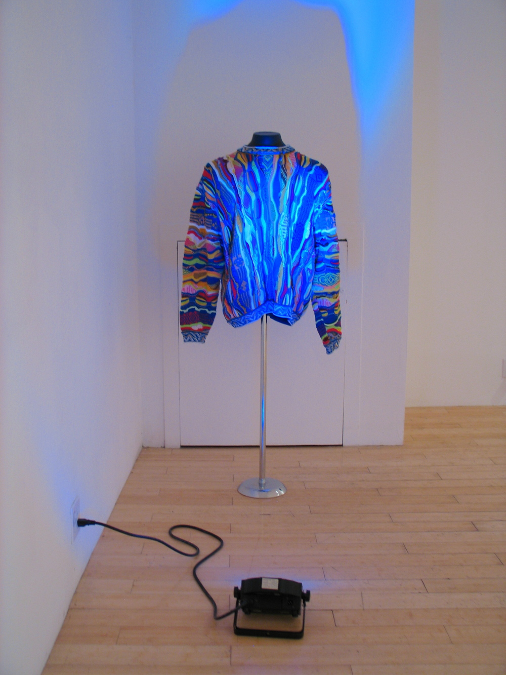 Constant Dullaart   Trui   2012  Coogi sweater, mannequin stand, RGB LED light  4 x 24 x 48 in/ 10.2 x 10.2 x 121.9 cm  Edition 1 of 3 with 2 AP