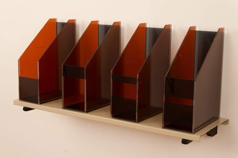 Lukas Geronimas  Love Children  2012 Metal shelf, plexiglas, wood, fasteners and ink  35  ¼  x 17 x 11  ½  in/ 89.5 x 43.2 x 29.2 cm