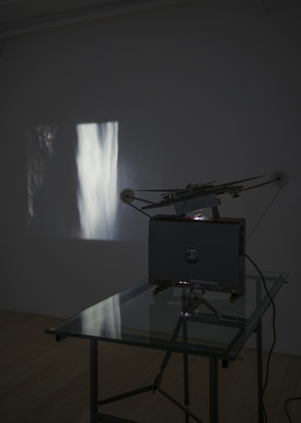 Record Volume   2014 Silent 16mm film, projectors, glass tables, loopers Runtime 2:00 minutes