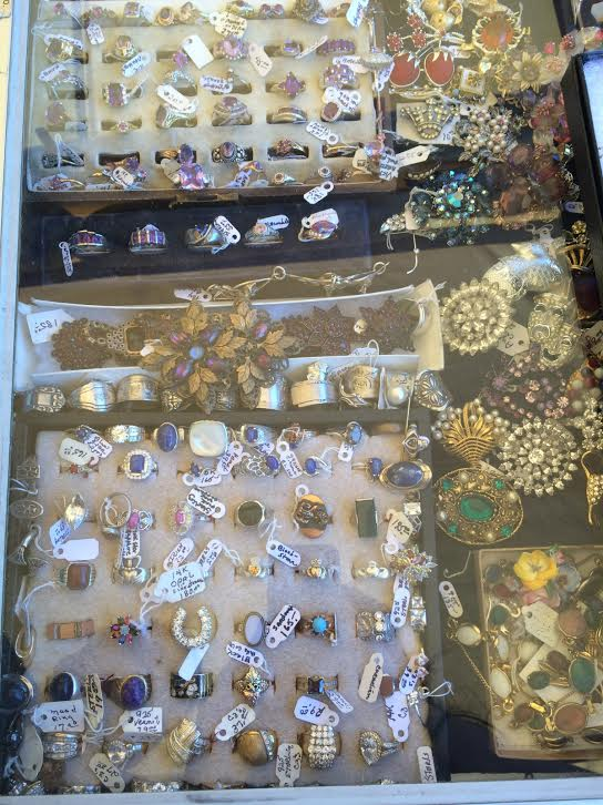 This dealer had a drool-worth collection of antique jewelry. All of her fine rings were sorted by gemstone color!