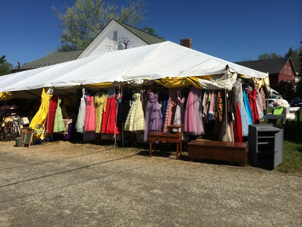 A tent full of vintage clothing