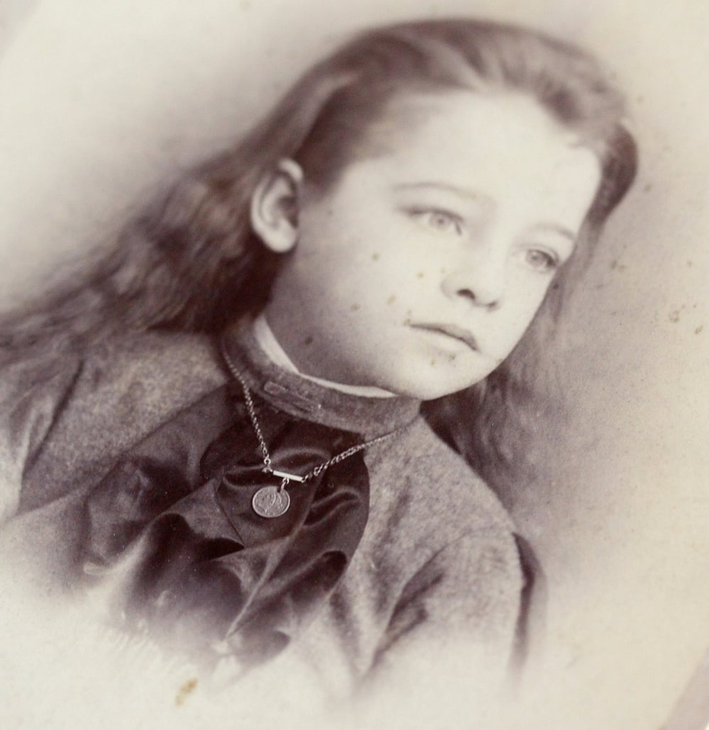 Victorian era cabinet card from Birmingham, Connecticut, featuring a vignette of an usually attractive androgynous young child wearing a love token charm necklace. (This is one of my favorite pictures from my personal collection!)