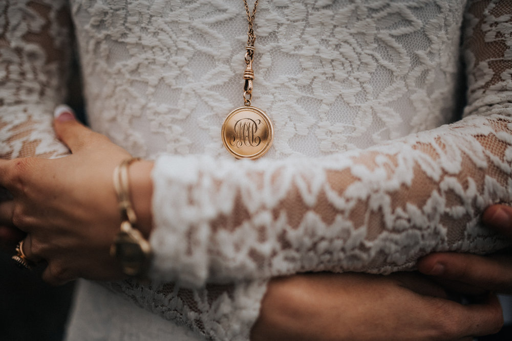 Our antique 1909 locket, which has the bride & grooms initials on it, (and was Malia's first antique jewelry purchase) matches perfectly with her grandmother's aunt's pocket watch chain that was worn during her time as a nurse in the war.  Antique Monogrammed Locket -  Maejean Vintage   Photography -  Will Khoury